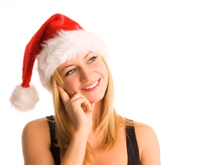 Beautiful happiness woman in santa hat isolated on white photo