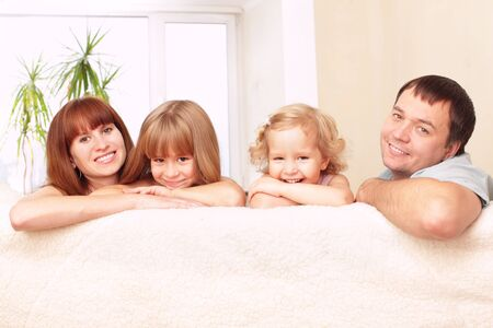 Happy family with two children on sofa Stock Photo - 9290011