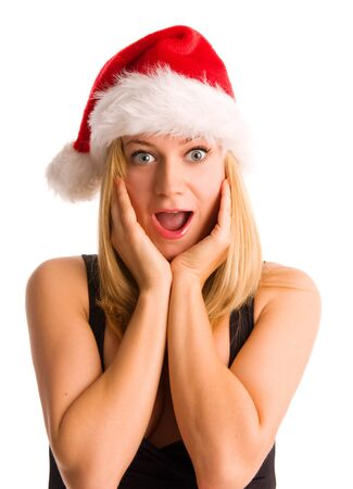 Surprised woman in a Christmas hat isolated on white photo