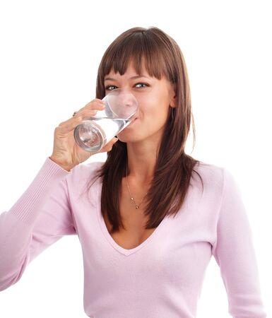 purified water: Joven bebiendo agua de un vaso