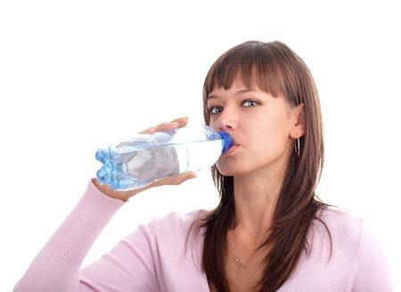 Young woman drinks pure water from a bottle