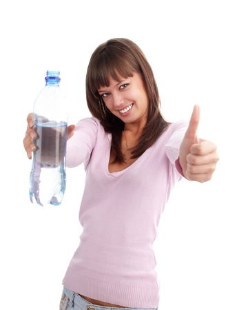 Young woman with a water bottle photo