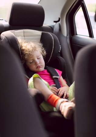 child sleeps in the car photo