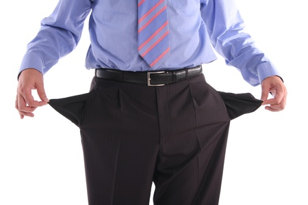 moneyless: The gone bankrupt businessman stands with the turned out pockets