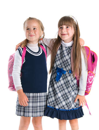 school uniform girl: Happy schoolgirls isolated on a white background