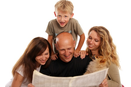 Family reads the newspaper photo