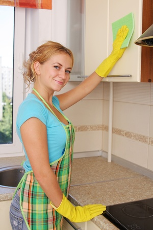 Girl washes kitchen set 2 photo