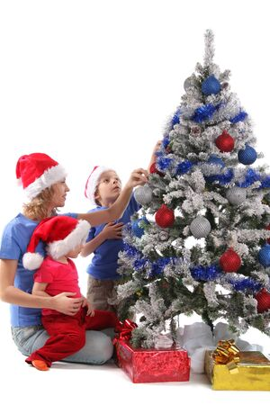 Happy mother and children over christmas tree 2 photo