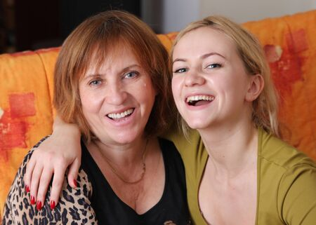 Beautiful and happy mum with a daughter of the house photo
