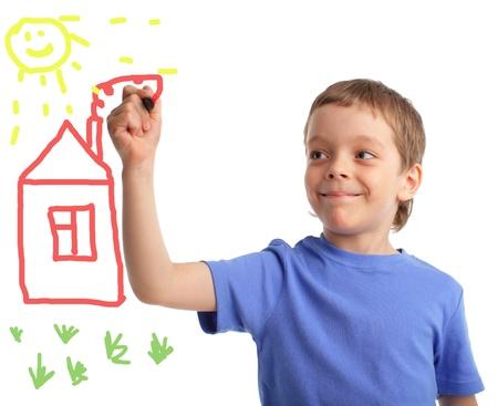 Boy draws the house on white background photo