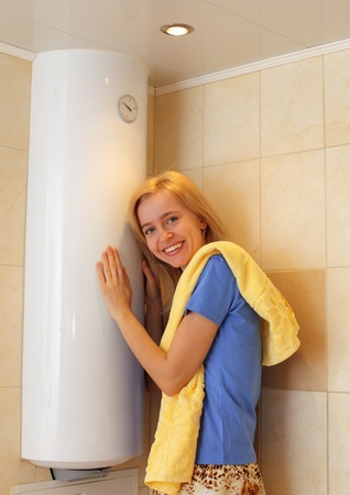 Happiness girl about a water heater  photo