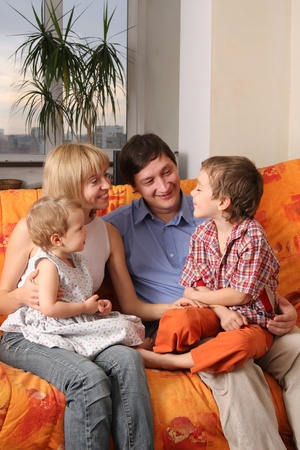 Happy family of the house on a sofa 3 Stock Photo - 9480832