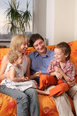 Happy family of the house on a sofa 5 Stock Photo - 9480830