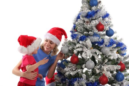 happy mother and daughter over christmas tree 5 photo