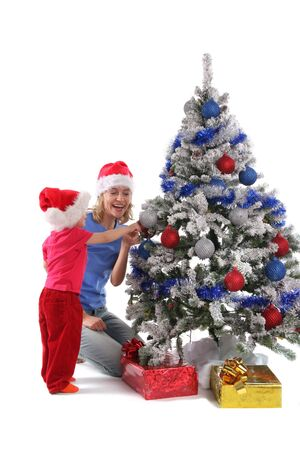 happy mother and daughter over christmas tree 6 photo