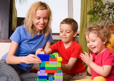 Mum with two children plays cubes  photo