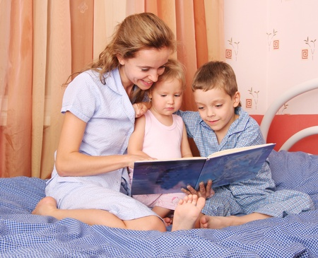Mum reads the book to the children 2 Stock Photo - 9480777