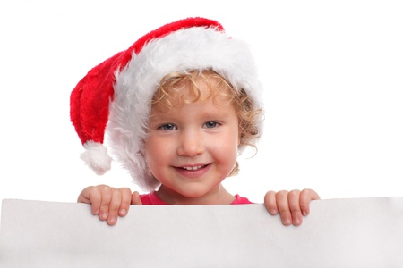 Little girl in a Christmas hat with blank photo