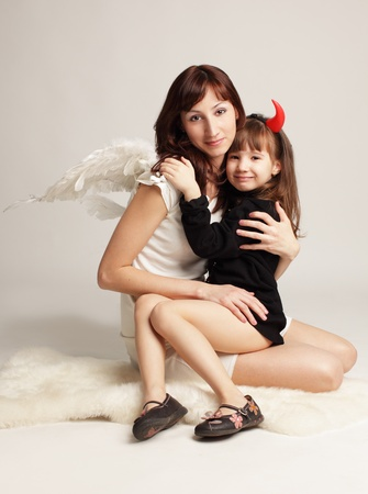 Angel and little demon.  photo