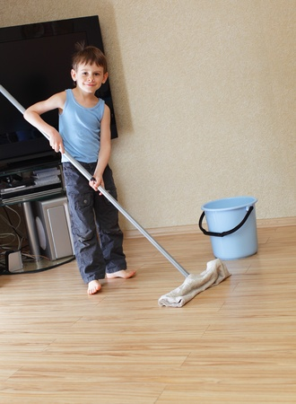 housework: Little boy a washing floor
