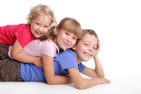 Happy children isolated on white  photo