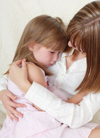 consoling: Mother calms the sad daughter