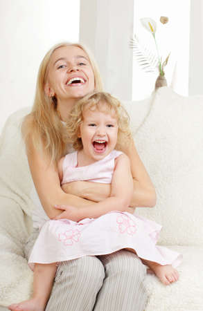 Happy mother with a daughter at home Stock Photo - 9626483