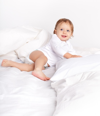 baby bed: Baby laying on a bed