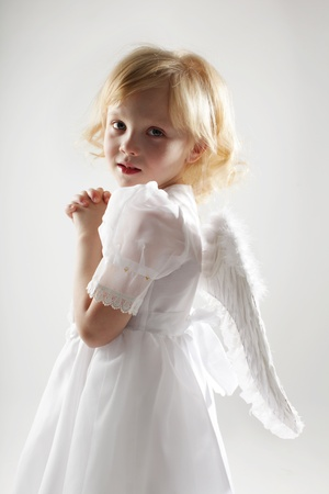 baby girls smiley face: Child with wings of an angel Stock Photo