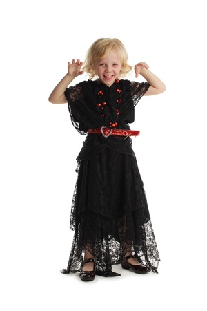 Happy girl in costume of a witch isolated on white Stock Photo - 10291765