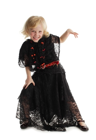Little girl in costume of a witch isolated on white Stock Photo - 10291772