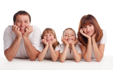 Happy family with two children isolated on white photo