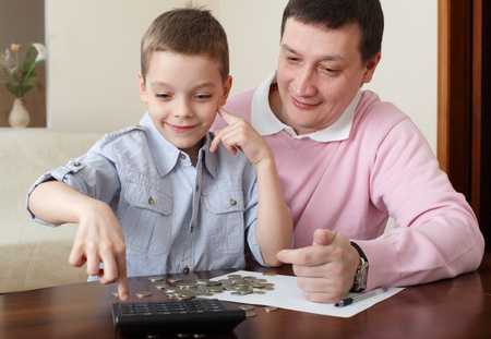 Father training the son to the finance. Series Stock Photo - 10231466