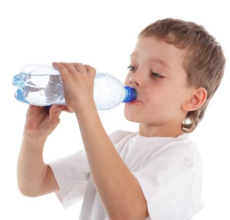 Boy with a water bottle isolated on white photo
