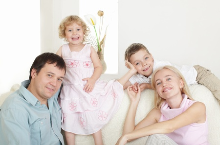 Happy family with two children on sofa Stock Photo - 10233504