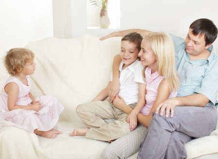 Happy family with two children on sofa Stock Photo - 10291565