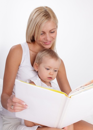 Mother reading book to a daughter at home Stock Photo - 10233490