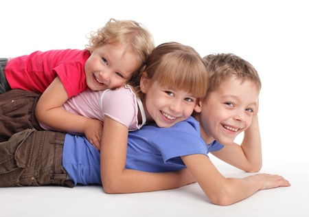 brothers and sisters: Happy children isolated on white