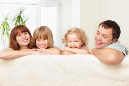 Happy family with two children on sofa Stock Photo - 10998425