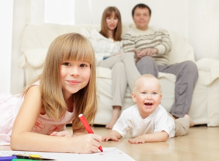 Happy family with two children at home photo