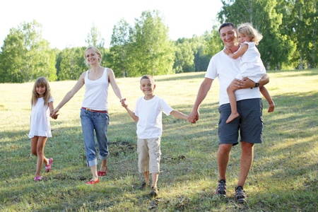 big family: Happy family with three children walking on park
