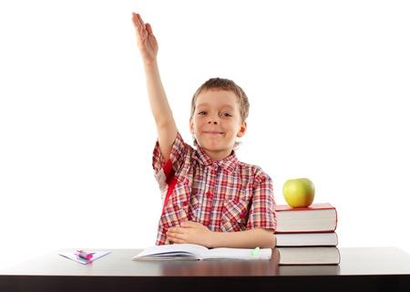 Happy schoolboy behind a school desk Stock Photo - 11110479