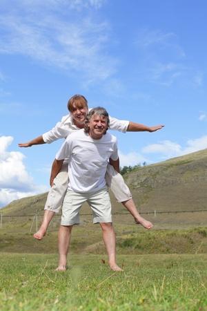 Happy adult couple outdoors photo