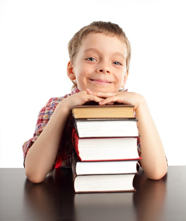 boys only: Schoolboy with books isolated on white