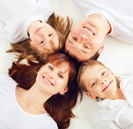 Happiness family on the white background photo