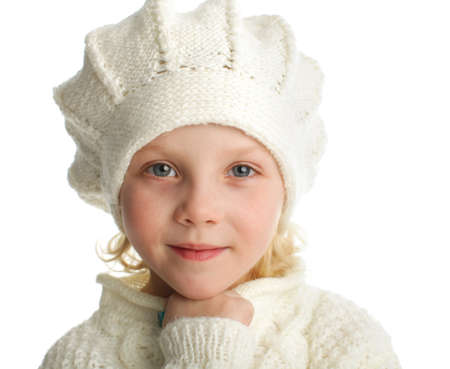 Portrait of a little girl in knitted hat photo