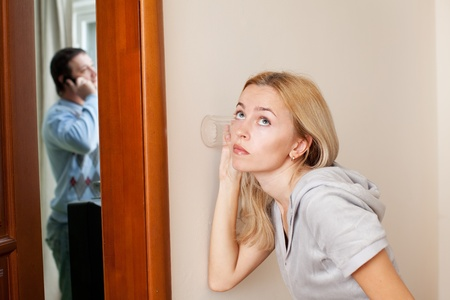 betrayal: Jealous wife, overhearing a phone conversation her husband Stock Photo