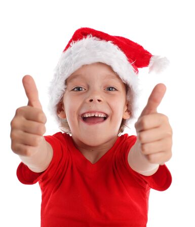 Happy child in christmas hat isolated on white photo