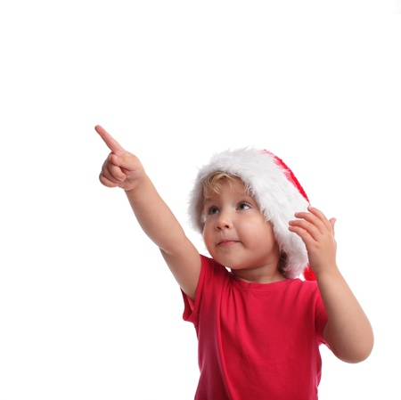 index finger: Little girl in santa hat isolated on white