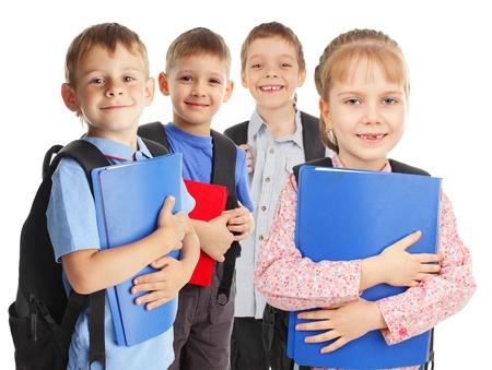 children only: Happy schoolchild isolated on white